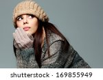 young pensive woman in warm... | Shutterstock . vector #169855949