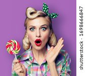 Small photo of Excited surprised woman with lollipop. Girl pin up with open mouth. Blond model - retro fashion and vintage concept. Violet purpure color background.