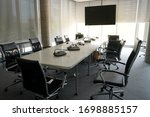 Small photo of an empty meeting room at the office during Covid-19 situation everyone work from home, social distancing