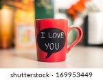 red ceramic cup with i love you ... | Shutterstock . vector #169953449