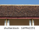 Old Brown Roof Tile And Sky