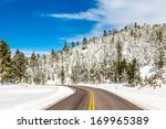 Winter Road In Snowy Forest On...