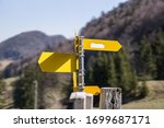 Yellow Directional Sign Post On ...
