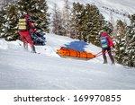 Two Members Of A Ski Patrol...