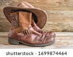 Cowboy Boots And Hat On A...