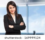 beautiful young businesswoman... | Shutterstock . vector #169999124