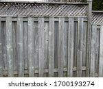 Small photo of Greyed cedar wooden fence texture
