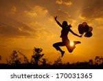 woman with balloons jumping on... | Shutterstock . vector #170031365