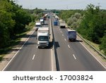 highway with trucks passing by | Shutterstock . vector #17003824