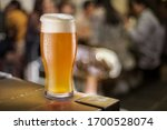 Glass Of Beer Stands On A Tabl...