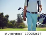 Golf Player Walking And...