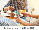 graphic designers discuss and...