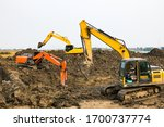 Digger Working Against A...