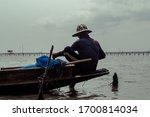 Thai Rural Fisherman On An Old...