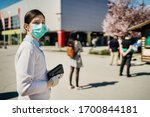 Shopper With Mask Standing In...