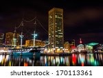 The USS Constellation and World Trade Center at night, in the Inner Harbor of Baltimore, Maryland.