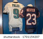 Small photo of Canton, Oh / USA - April 17, 2019: Pro football memorabilia on display at the Pro Football Hall of Fame. Foles number nine and Hester number 23 jerseys.
