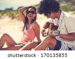 cute hispanic couple playing... | Shutterstock . vector #170135855