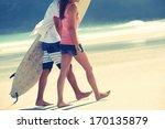 hispanic couple walk on beach...   Shutterstock . vector #170135879