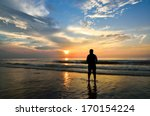 Silhouette Of A Man Looking To...