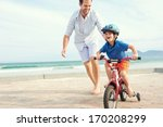 father and son learning to ride ... | Shutterstock . vector #170208299