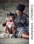 Rural African Mother And Baby...