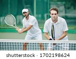 Doubles Team Of Tennis Players...