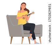a young girl is playing ukulele.   Shutterstock .eps vector #1702829851