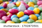 Small photo of Candies in multi-colored glaze. Multi-colored dragee. Blurred photo. Sweet shop. Background from multi-colored dragees in glaze. Raisins, almonds covered with colorful glaze. Candy background.