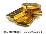Several gold bars of different weight isolated on a white background. - stock photo