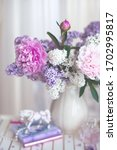 Bouquet Of Lilacs In A White...