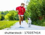 Stock photo young attractive sport girl running with dog in park 170357414