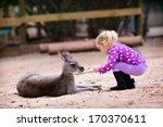 Cute Young Girl And Kangaroo I...