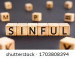 Small photo of Sinful - word from wooden blocks with letters, wicked and immoral sinful concept, random letters around white background