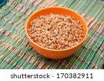Buckwheat In An Orange Bowl