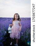 Little Girl Holding A White...