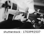 Player Plaing On Guitar. Macro...