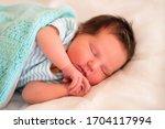 Little Newborn Baby In Striped...