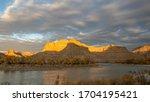 Sun Lights Up Desert Cliffs...