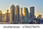 Calgary City. Sunset Downtown. Calgary Saddledome Sunset. Sun hits the buildings.