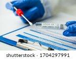 Medical Worker Holding...