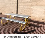 Metal Bench With Yellow Legs ...