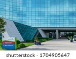 Small photo of Overland Park, KS / United States of America - May 19th, 2019 : Advent Health patient drop off area. Formerly the Shawnee Mission Health Center, hospital entrance, glass building with blue reflection
