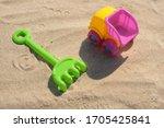 Colorful Beach Toys At A Beach...