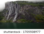 View of waterfalls at the Geiranger Fjord near the town of Geiranger, Norway - stock photo