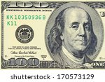 "Small photo of Macro shot of a 100 dollar. Benjamin Franklin as depicted on the bill. ""This Note Is Legal Tender For All Debts, Public And Private"""