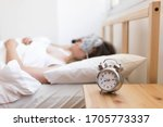 alarm clock on bedside table...   Shutterstock . vector #1705773337