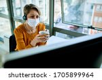 Small photo of Businesswoman with face mask holding a cup of coffee while reading problematic e-mail on desktop PC in the office.