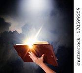 human hand holding magic book... | Shutterstock . vector #170599259