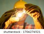 Electrician With Light Bulbs...